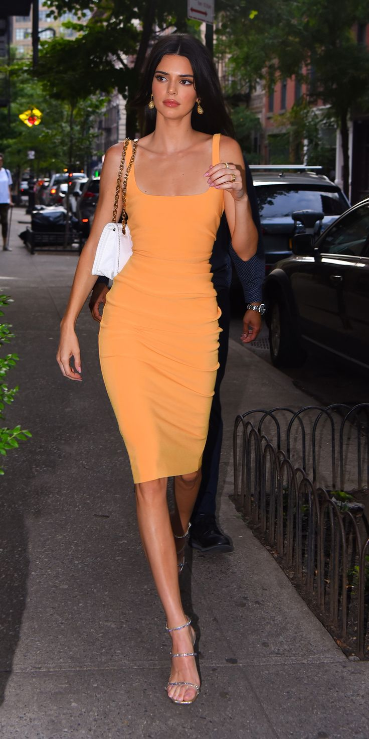 Kendall Jenner stopped by a NYC bodega in a body-hugging orange dress by Bec & B...