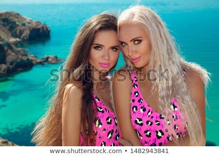 Stock Photo: Bikini models. Close up summer portrait of young sexy pretty women,...