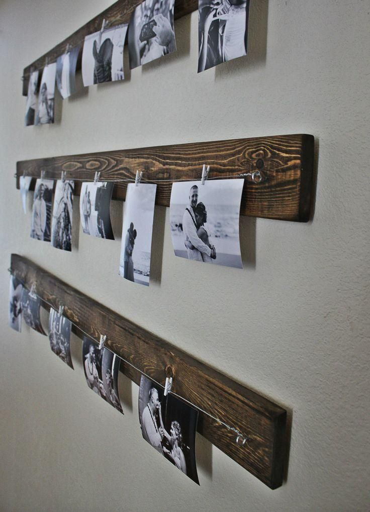 hipster way of displaying your family photo is done easily with wooden planks, c...