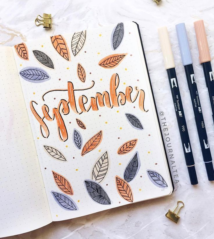 Autumn leaves flying around in the beautiful bullet journal cover by ig@thejourn...