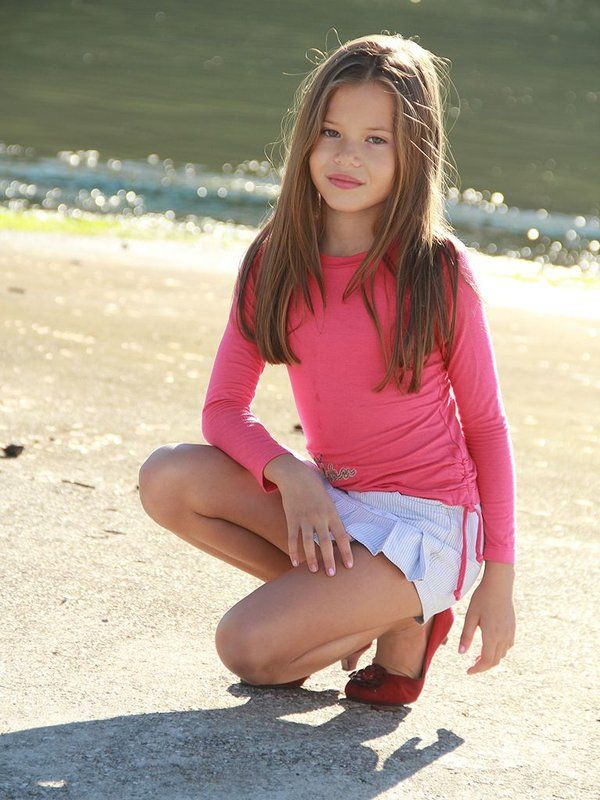 Pink long sleeve pullover and cute striped pleated skirt. Girls 6-12