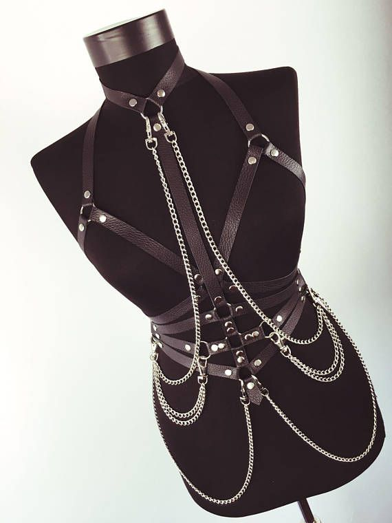 Drape yourself in leather and chains with this sexy BDSM harness. Made from genu...