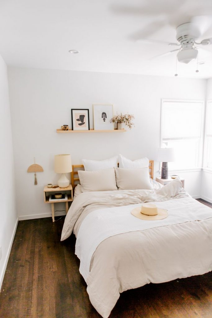 Bone Linen Bedding adds a soft touch to this mid-century modern bedroom. Layer w...