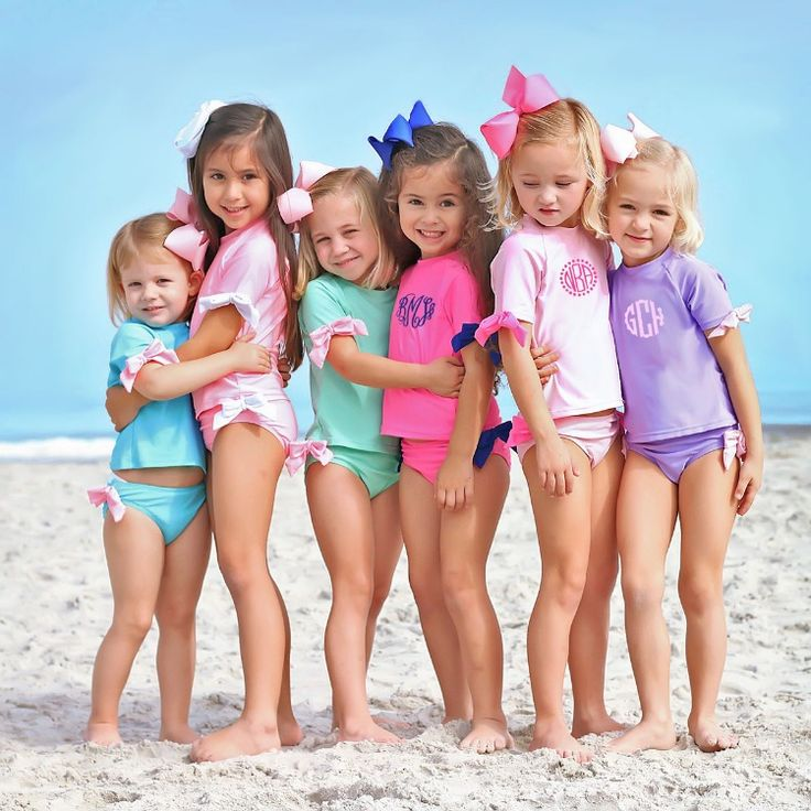 Adorable two piece swimsuit with bow details. Short sleeve rash guard set. UPF 5...