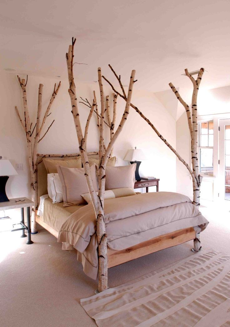 Birch trunks as construction of the bed in the bedroom