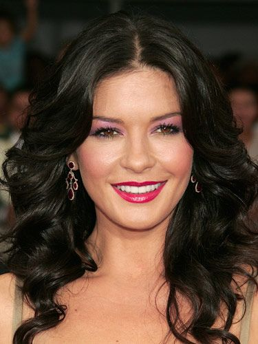 Catherine Zeta-Jones, she of the fantastic hair and bold makeup choices