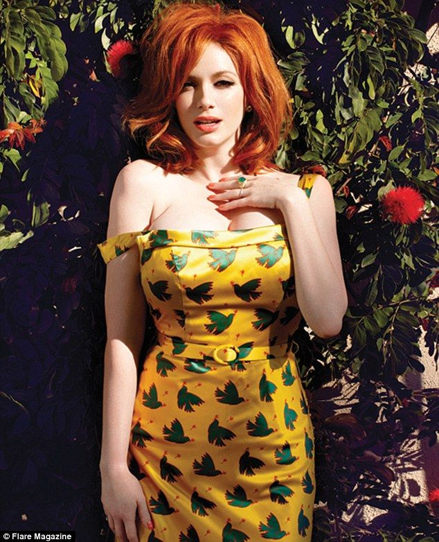 Actress Christina Hendricks pours out of a yellow dress with green peace doves i...