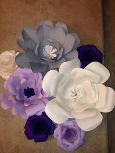 Giant paper flowers for my baby shower. Purple/gray butterfly/floral themed.