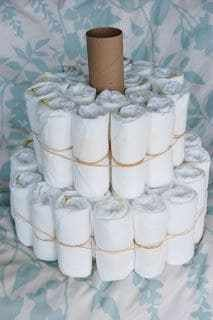How to make a diaper cake for a baby shower on a budget. Baby shower ideas and i...
