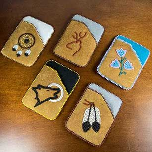 Carry you credit or debit cards in style with a hand beaded moosehide card holde...