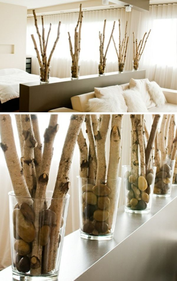 Glass vases with birch branches in the bedroom