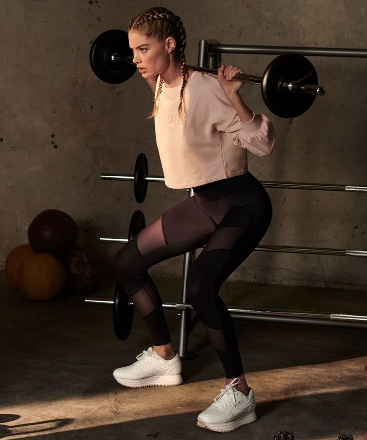 Pumping some iron, the Dutch model shows off her workout routine. Doutzen Kroes....