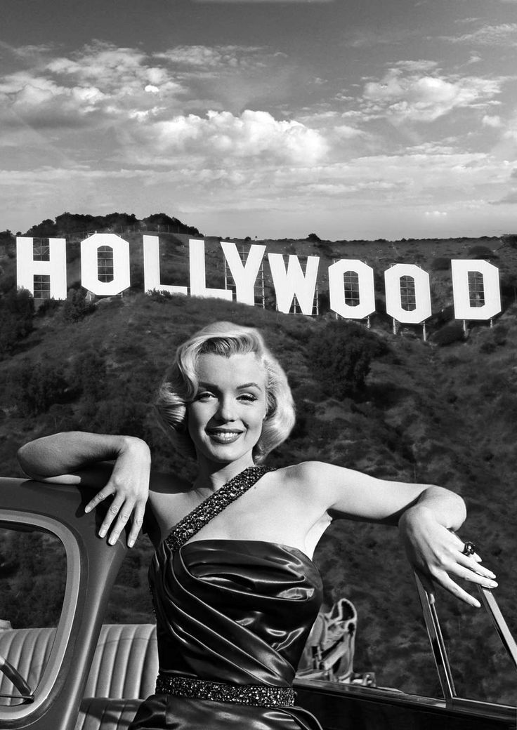 Actress Marilyn Monroe in front of the Hollywood sign. Available now at: www.ets...