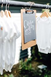 Onesie painting baby shower station: www.stylemepretty... | Photographer: M&Him ...